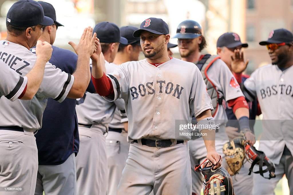 <a gi-track='captionPersonalityLinkClicked' href=/galleries/search?phrase=Shane+Victorino&family=editorial&specificpeople=576251 ng-click='$event.stopPropagation()'>Shane Victorino</a> #18 of the Boston Red Sox celebrates a win with teammates after a baseball game against the Baltimore Orioles on June 15, 2013 at Oriole Park at Camden Yards in Baltimore, Maryland. The Red Sox won 5-4.