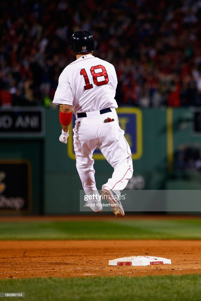 <a gi-track='captionPersonalityLinkClicked' href=/galleries/search?phrase=Shane+Victorino&family=editorial&specificpeople=576251 ng-click='$event.stopPropagation()'>Shane Victorino</a> #18 of the Boston Red Sox celebrates after hitting a grand slam home run against Jose Veras #31 of the Detroit Tigers in the seventh inning during Game Six of the American League Championship Series at Fenway Park on October 19, 2013 in Boston, Massachusetts.