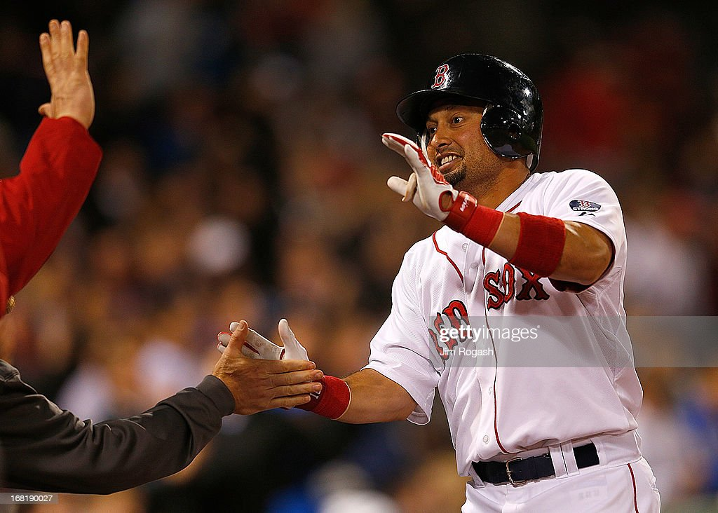 Shane Victorino #18 of the Boston Red Sox celebrates his home run with teammates during a game with the Minnesota Twins in the 4th inning at Fenway Park on May 6, 2013 in Boston, Massachusetts.