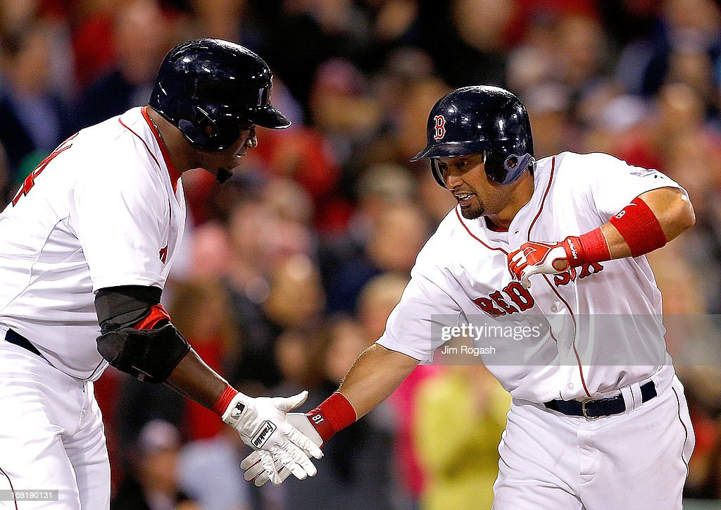 Shane Victorino #18 of the Boston Red Sox celebrates his home run with David Ortiz #34 during a game with the Minnesota Twins in the 4th inning at Fenway Park on May 6, 2013 in Boston, Massachusetts.