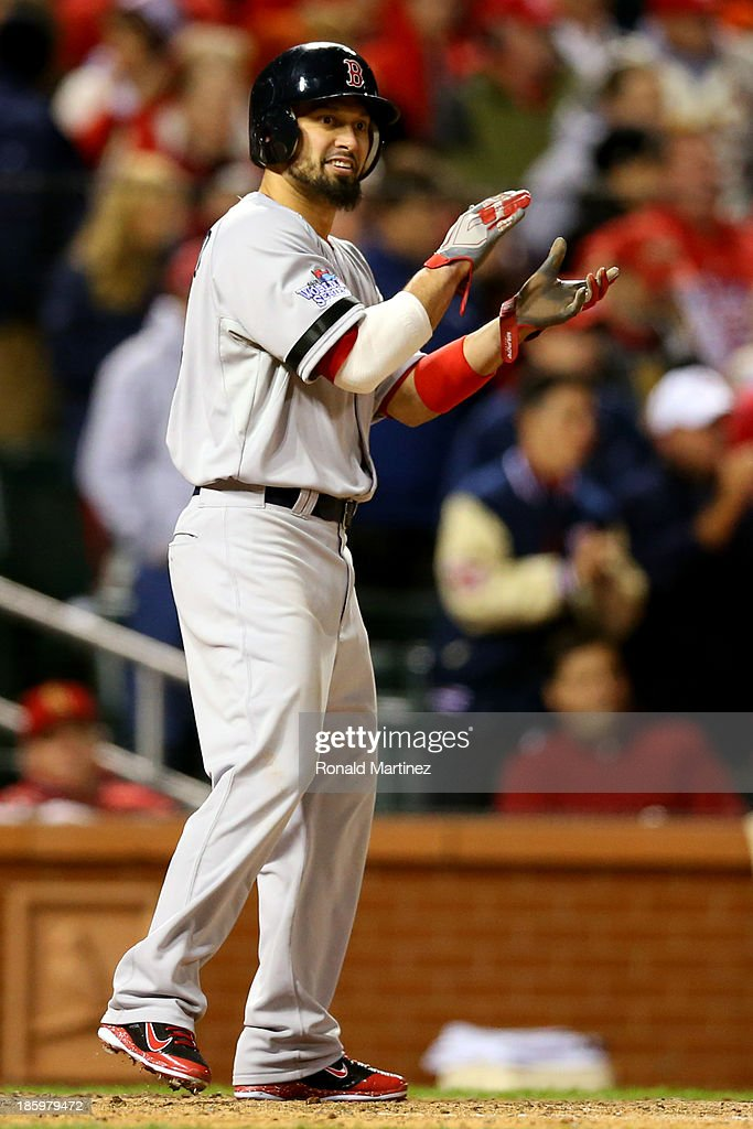 <a gi-track='captionPersonalityLinkClicked' href=/galleries/search?phrase=Shane+Victorino&family=editorial&specificpeople=576251 ng-click='$event.stopPropagation()'>Shane Victorino</a> #18 of the Boston Red Sox celebrates scoring on a single by Xander Bogaerts #72 in the eighth inning against the St. Louis Cardinals during Game Three of the 2013 World Series at Busch Stadium on October 26, 2013 in St Louis, Missouri.