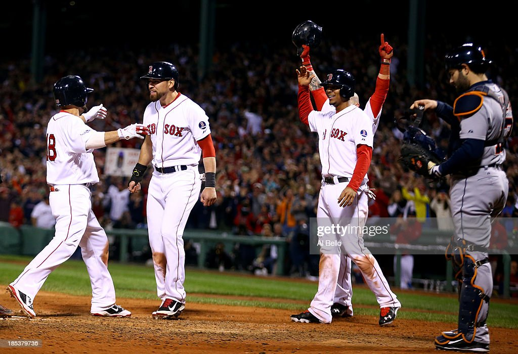 <a gi-track='captionPersonalityLinkClicked' href=/galleries/search?phrase=Shane+Victorino&family=editorial&specificpeople=576251 ng-click='$event.stopPropagation()'>Shane Victorino</a> #18 of the Boston Red Sox celebrates with his teammates after hitting a grand slam home run against Jose Veras #31 of the Detroit Tigers in the seventh inning during Game Six of the American League Championship Series at Fenway Park on October 19, 2013 in Boston, Massachusetts.