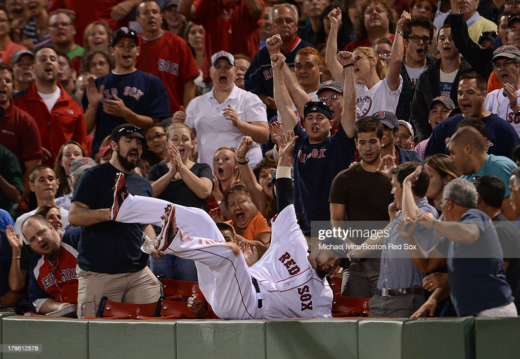 <a gi-track='captionPersonalityLinkClicked' href=/galleries/search?phrase=Shane+Victorino&family=editorial&specificpeople=576251 ng-click='$event.stopPropagation()'>Shane Victorino</a> #18 of the Boston Red Sox falls into the stands after catching a fly ball hit by Austin Jackson #14 of the Detroit Tigers during the fourth inning on September 4, 2013 at Fenway Park in Boston Massachusetts.