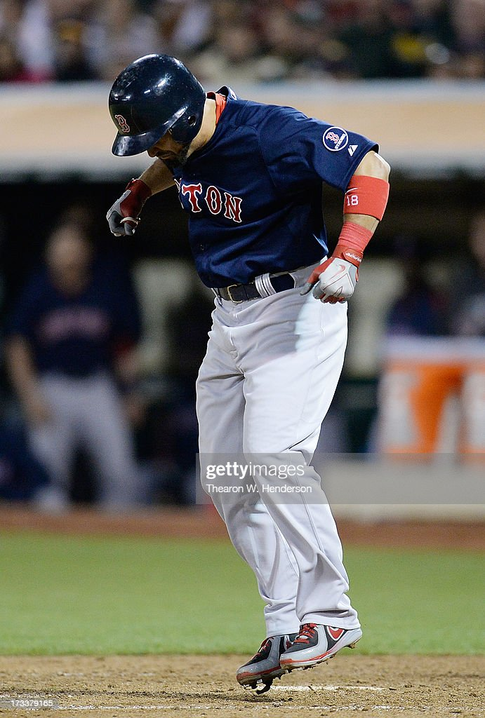<a gi-track='captionPersonalityLinkClicked' href=/galleries/search?phrase=Shane+Victorino&family=editorial&specificpeople=576251 ng-click='$event.stopPropagation()'>Shane Victorino</a> #18 of the Boston Red Sox hops in pain after getting hit in the hand with a pitch in the eighth inning against the Oakland Athletics at O.co Coliseum on July 12, 2013 in Oakland, California.
