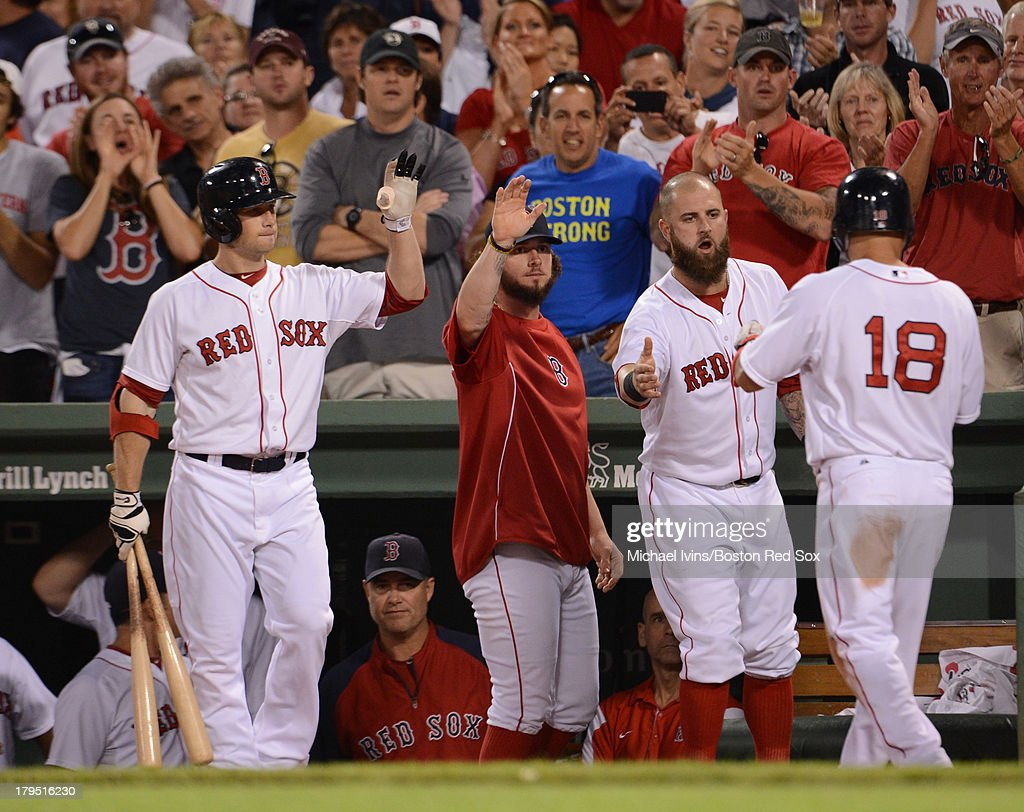 <a gi-track='captionPersonalityLinkClicked' href=/galleries/search?phrase=Shane+Victorino&family=editorial&specificpeople=576251 ng-click='$event.stopPropagation()'>Shane Victorino</a> #16 of the Boston Red Sox is congratulated by <a gi-track='captionPersonalityLinkClicked' href=/galleries/search?phrase=Daniel+Nava&family=editorial&specificpeople=670454 ng-click='$event.stopPropagation()'>Daniel Nava</a> #29, <a gi-track='captionPersonalityLinkClicked' href=/galleries/search?phrase=Jarrod+Saltalamacchia&family=editorial&specificpeople=836404 ng-click='$event.stopPropagation()'>Jarrod Saltalamacchia</a> #39 and <a gi-track='captionPersonalityLinkClicked' href=/galleries/search?phrase=Mike+Napoli&family=editorial&specificpeople=525007 ng-click='$event.stopPropagation()'>Mike Napoli</a> #12 after scoring against the Detroit Tigers during the fifth inning on September 4, 2013 at Fenway Park in Boston Massachusetts.