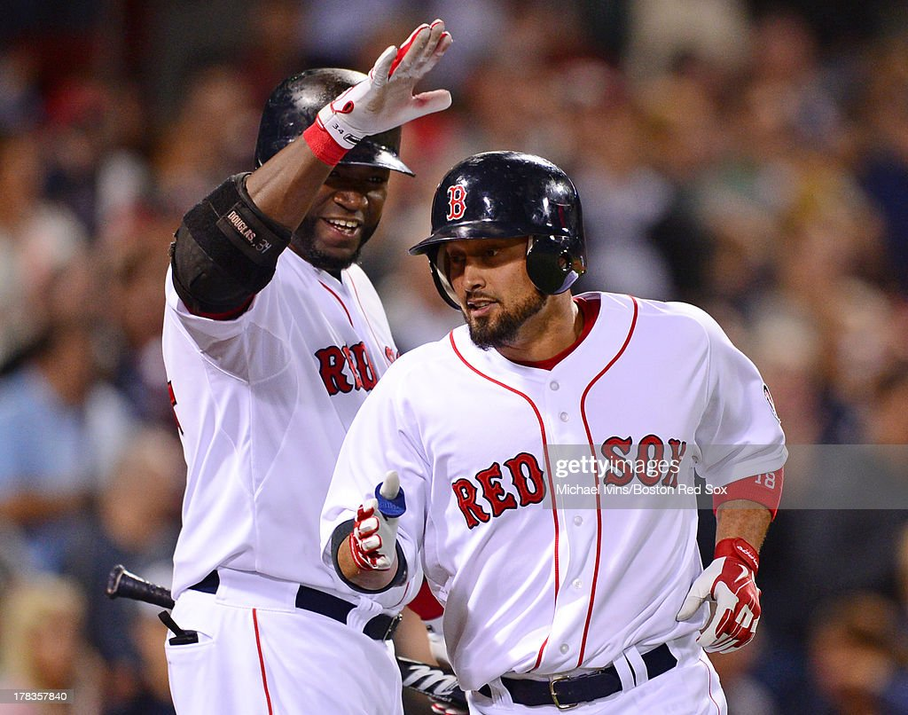 Shane Victorino #19 of the Boston Red Sox is congratulated by David Ortiz #34 after hitting a home run against the Baltimore Orioles during the sixth inning on August 29, 2013 at Fenway Park in Boston Massachusetts.