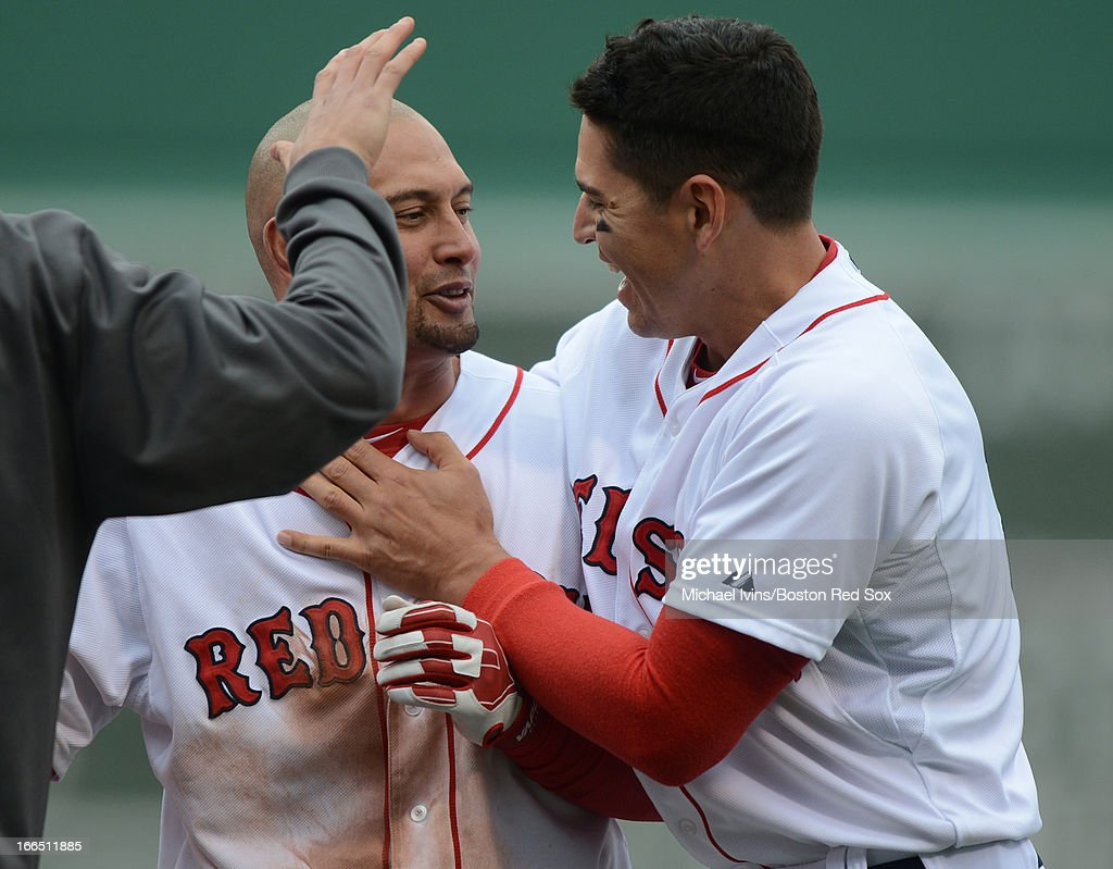 <a gi-track='captionPersonalityLinkClicked' href=/galleries/search?phrase=Shane+Victorino&family=editorial&specificpeople=576251 ng-click='$event.stopPropagation()'>Shane Victorino</a> #18 of the Boston Red Sox is congratulated by <a gi-track='captionPersonalityLinkClicked' href=/galleries/search?phrase=Jacoby+Ellsbury&family=editorial&specificpeople=4172583 ng-click='$event.stopPropagation()'>Jacoby Ellsbury</a> #2 after hitting a game winning single against the Tampa Bay Rays in the tenth inning on April 13, 2013 at Fenway Park in Boston, Massachusetts.