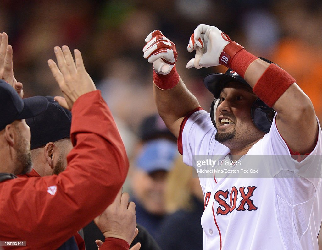 Shane Victorino #16 of the Boston Red Sox is greeted by teammates after hitting a home run against the Minnesota Twins in the fourth inning on May 6, 2013 at Fenway Park in Boston, Massachusetts.