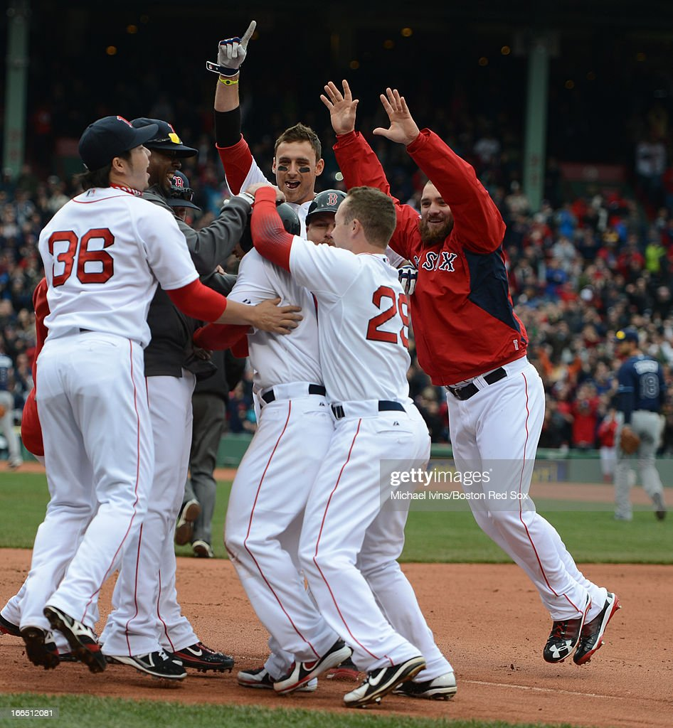 <a gi-track='captionPersonalityLinkClicked' href=/galleries/search?phrase=Shane+Victorino&family=editorial&specificpeople=576251 ng-click='$event.stopPropagation()'>Shane Victorino</a> #18 of the Boston Red Sox is mobbed by teammates after hitting a game-winning single against the Tampa Bay Rays in the tenth inning on April 13, 2013 at Fenway Park in Boston, Massachusetts.