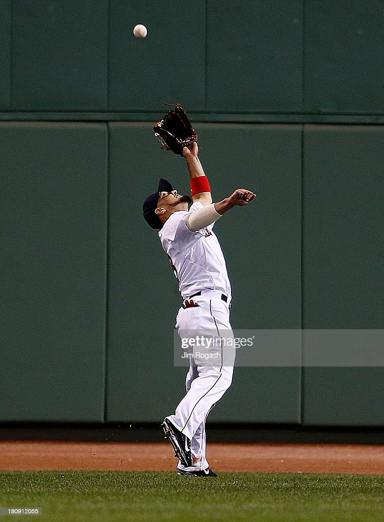 Shane Victorino #18 of the Boston Red Sox makes a catch on a ball hit by Nick Markakis #21 of the Baltimore Orioles in the 6th inning at Fenway Park on September 17 in Boston, Massachusetts.