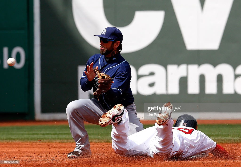<a gi-track='captionPersonalityLinkClicked' href=/galleries/search?phrase=Shane+Victorino&family=editorial&specificpeople=576251 ng-click='$event.stopPropagation()'>Shane Victorino</a> #18 of the Boston Red Sox safely steals second base as Ryan Roberts #19 of the Tampa Bay Rays awaits the ball in the third inning at Fenway Park on April 13, 2013 in Boston, Massachusetts.