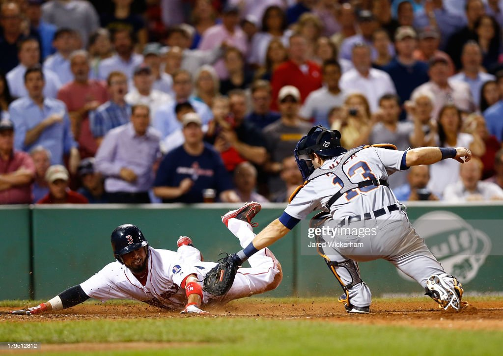 <a gi-track='captionPersonalityLinkClicked' href=/galleries/search?phrase=Shane+Victorino&family=editorial&specificpeople=576251 ng-click='$event.stopPropagation()'>Shane Victorino</a> #18 of the Boston Red Sox slides safely into home plate past <a gi-track='captionPersonalityLinkClicked' href=/galleries/search?phrase=Alex+Avila&family=editorial&specificpeople=5749211 ng-click='$event.stopPropagation()'>Alex Avila</a> #13 of the Detroit Tigers on a sacrifice fly in the fifth inning during the game on September 4, 2013 at Fenway Park in Boston, Massachusetts.