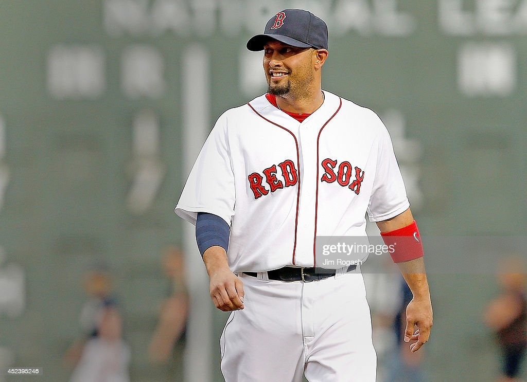 Shane Victorino #18 of the Boston Red Sox smiles as he warms up before a game with the Kansas City Royals at Fenway Park on July 19, 2014 in Boston, Massachusetts.