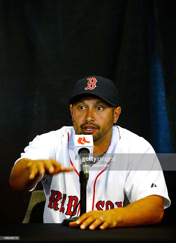 <a gi-track='captionPersonalityLinkClicked' href=/galleries/search?phrase=Shane+Victorino&family=editorial&specificpeople=576251 ng-click='$event.stopPropagation()'>Shane Victorino</a> of the Boston Red Sox speaks during a press conference, after signing a three-year contract, on December 13, 2012 at Fenway Park in Boston, Massachusetts.