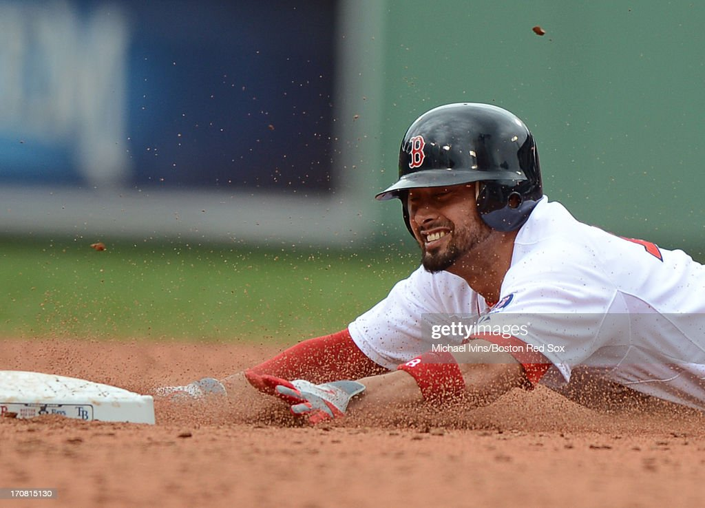 Shane Victorino #18 of the Boston Red Sox steals second base against the Tampa Bay Rays in the third inning on June 18, 2013 at Fenway Park in Boston, Massachusetts.