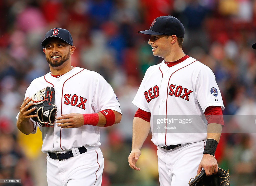 Shane Victorino #18 of the Boston Red Sox, who had three hits, and Daniel Nava #29 of the Boston Red Sox, who had two runs batted in, celebrate after defeating the Colorado Rockies, 5-3, at Fenway Park on June 26, 2013 in Boston, Massachusetts.