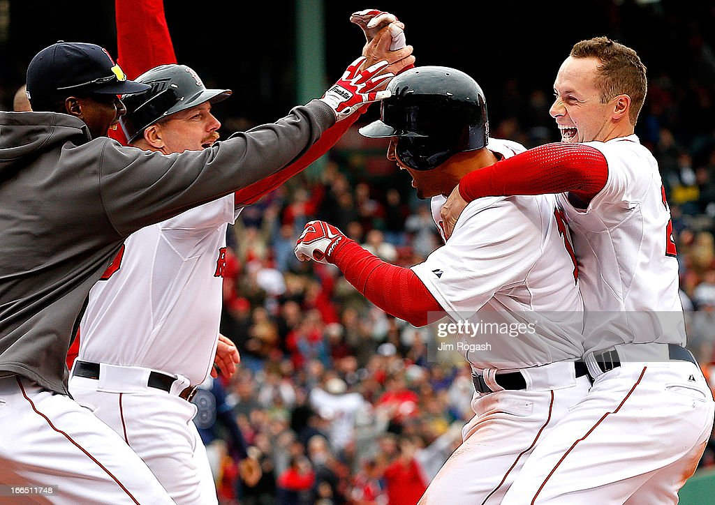<a gi-track='captionPersonalityLinkClicked' href=/galleries/search?phrase=Shane+Victorino&family=editorial&specificpeople=576251 ng-click='$event.stopPropagation()'>Shane Victorino</a> #18 of the Boston Red Sox, with helmet celebrates with teammates after he singled in the winning run in the 9th inning against the Tampa Bay Rays at Fenway Park on April 13, 2013 in Boston, Massachusetts.