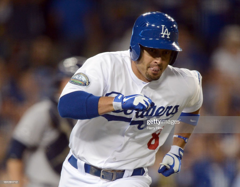 <a gi-track='captionPersonalityLinkClicked' href=/galleries/search?phrase=Shane+Victorino&family=editorial&specificpeople=576251 ng-click='$event.stopPropagation()'>Shane Victorino</a> #8 of the Los Angeles Dodgers reacts to his single to score A.J. Ellis #17 for a 2-1 lead over the San Diego Padres during the seventh inning at Dodger Stadium on September 4, 2012 in Los Angeles, California.