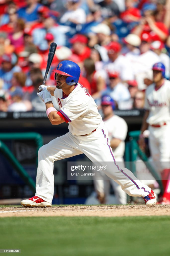 <a gi-track='captionPersonalityLinkClicked' href=/galleries/search?phrase=Shane+Victorino&family=editorial&specificpeople=576251 ng-click='$event.stopPropagation()'>Shane Victorino</a> #8 of the Philadelphia Phillies gets a base hit in the eighth inning of the game against the San Diego Padres at Citizens Bank Park on May 13, 2012 in Philadelphia, Pennsylvania. The Phillies won 3-2.
