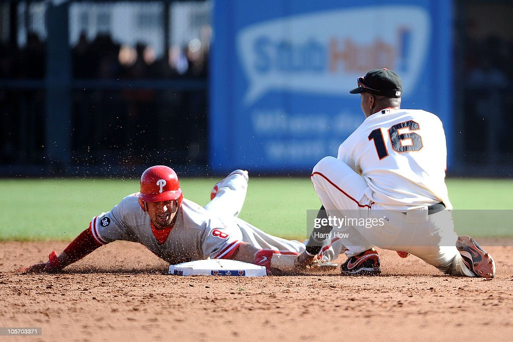 <a gi-track='captionPersonalityLinkClicked' href=/galleries/search?phrase=Shane+Victorino&family=editorial&specificpeople=576251 ng-click='$event.stopPropagation()'>Shane Victorino</a> #8 of the Philadelphia Phillies steals second base against the San Francisco Giants in the fifth inning of Game Three of the NLCS during the 2010 MLB Playoffs at AT&T Park on October 19, 2010 in San Francisco, California.
