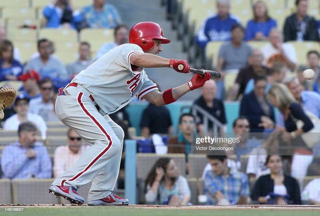 <a gi-track='captionPersonalityLinkClicked' href=/galleries/search?phrase=Shane+Victorino&family=editorial&specificpeople=576251 ng-click='$event.stopPropagation()'>Shane Victorino</a> #8 of the Philadelphia Phillies tries for the bunt during the MLB game against the Los Angeles Dodgers at Dodger Stadium on July 17, 2012 in Los Angeles, California. The Phillies defeated the Dodgers 3-2.