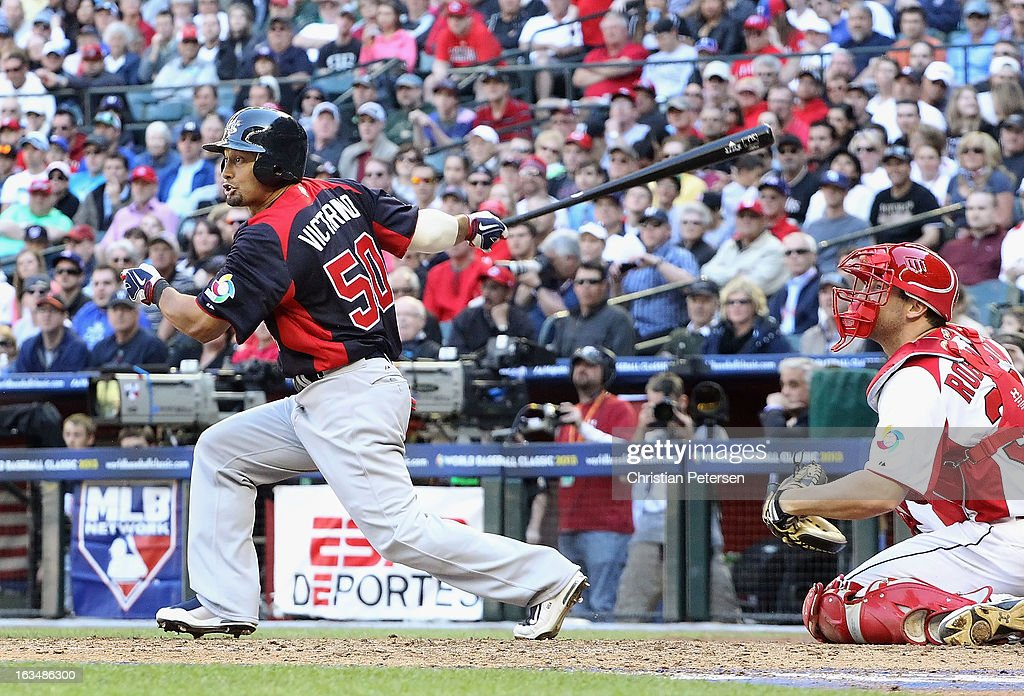 <a gi-track='captionPersonalityLinkClicked' href=/galleries/search?phrase=Shane+Victorino&family=editorial&specificpeople=576251 ng-click='$event.stopPropagation()'>Shane Victorino</a> #50 of USA hits a RBI single against Canada during the eighth inning of the World Baseball Classic First Round Group D game at Chase Field on March 10, 2013 in Phoenix, Arizona. USA defeated Canada 9-4.