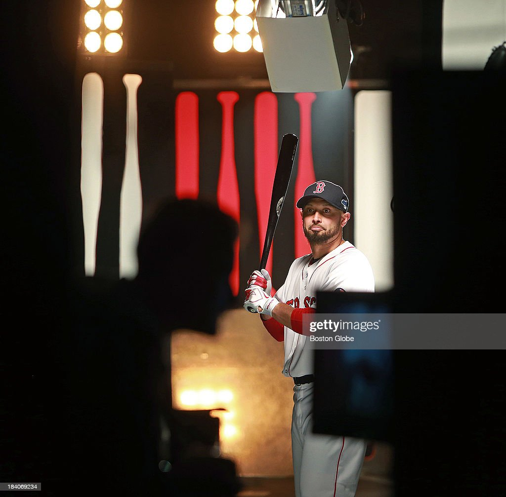 Shane Victorino takes his turn in front of the cameras outside of the Red Sox clubhouse, in their concourse behind home plate, where a makeshift studio was set up to film new promotional spots for the upcoming ALCS of the players in their home white uniforms. The Boston Red Sox had a workout at Fenway Park in preparation for Game One of the ALCS against either Oakland or Detroit.