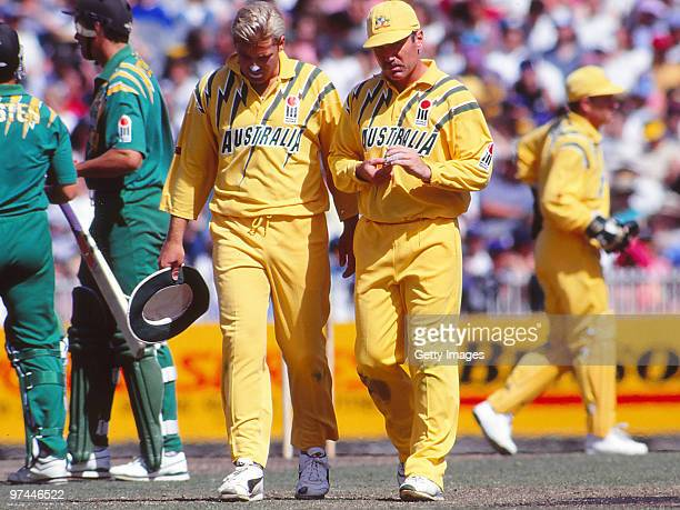 Shane Warne and Allan Border of Australia plan tactics during a One Day International match between Australia and South Africa on January 21 1994 in...
