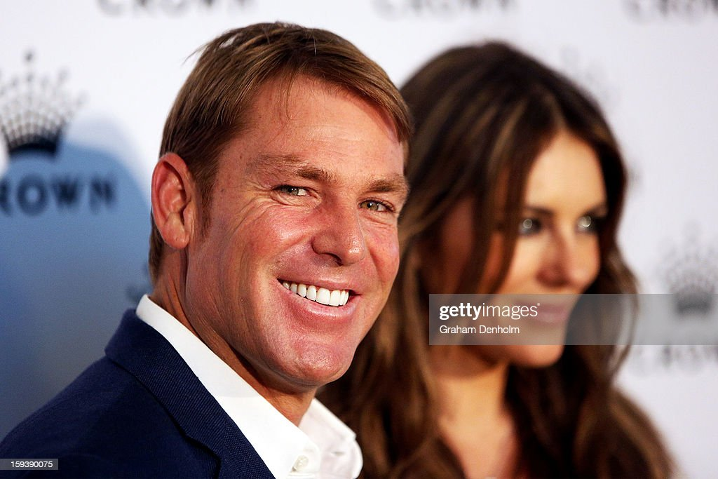 <a gi-track='captionPersonalityLinkClicked' href=/galleries/search?phrase=Shane+Warne&family=editorial&specificpeople=167242 ng-click='$event.stopPropagation()'>Shane Warne</a> (L) and <a gi-track='captionPersonalityLinkClicked' href=/galleries/search?phrase=Elizabeth+Hurley&family=editorial&specificpeople=201731 ng-click='$event.stopPropagation()'>Elizabeth Hurley</a> arrive at Crown's IMG Tennis Player's Party at Crown Towers on January 13, 2013 in Melbourne, Australia.