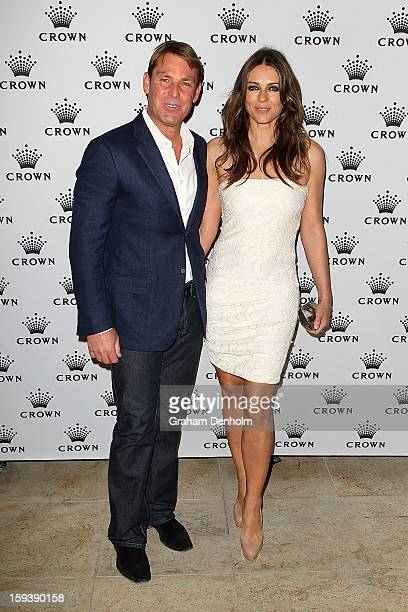 Shane Warne and Elizabeth Hurley arrive at Crown's IMG Tennis Player's Party at Crown Towers on January 13 2013 in Melbourne Australia