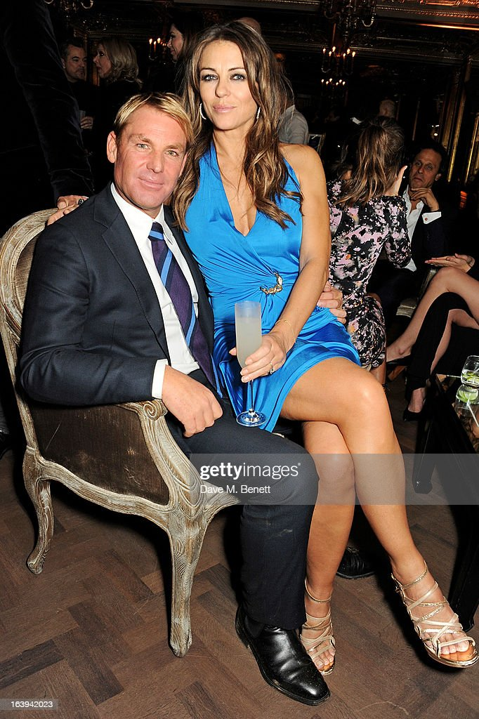 Shane Warne (L) and Elizabeth Hurley attend a party celebrating Patrick Cox's 50th Birthday party at Cafe Royal on March 15, 2013 in London, England.