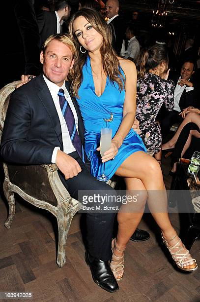 Shane Warne and Elizabeth Hurley attend a party celebrating Patrick Cox's 50th Birthday party at Cafe Royal on March 15 2013 in London England