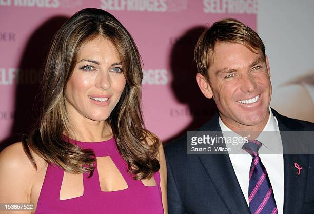 Shane Warne and Elizabeth Hurley attend a Photocall for Estee Lauder during Breast Cancer Awareness Month at Selfridges on October 8 2012 in London...