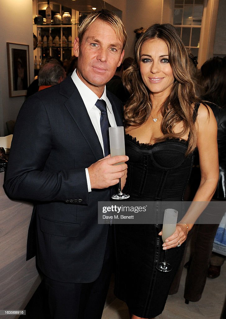Shane Warne (L) and Elizabeth Hurley attend the launch of Louise Fennell's new book 'Fame Game' at Grace Belgravia on March 12, 2013 in London, England.