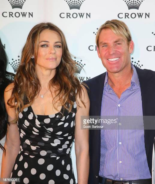 Shane Warne and Elizabeth Hurley attend the launch of the Shane Warne Foundation's Ambassador Program at Club 23 on November 12 2013 in Melbourne...