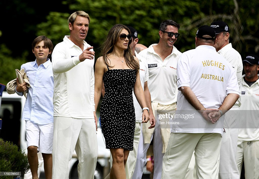 <a gi-track='captionPersonalityLinkClicked' href=/galleries/search?phrase=Shane+Warne&family=editorial&specificpeople=167242 ng-click='$event.stopPropagation()'>Shane Warne</a> and <a gi-track='captionPersonalityLinkClicked' href=/galleries/search?phrase=Elizabeth+Hurley&family=editorial&specificpeople=201731 ng-click='$event.stopPropagation()'>Elizabeth Hurley</a> look on prior to <a gi-track='captionPersonalityLinkClicked' href=/galleries/search?phrase=Shane+Warne&family=editorial&specificpeople=167242 ng-click='$event.stopPropagation()'>Shane Warne</a>'s Australia vs Michael Vaughan's England T20 match at Cirencester Cricket Club on June 09, 2013 in Cirencester, England.