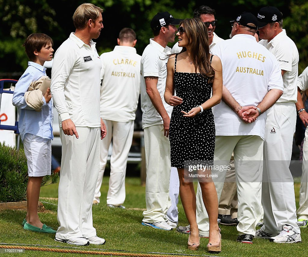 Shane Warne and Elizabeth Hurley talk during the Shane Warne's Australia vs Michael Vaughan's England T20 match at Circenster Cricket Club on June 9, 2013 in Cirencester, England.