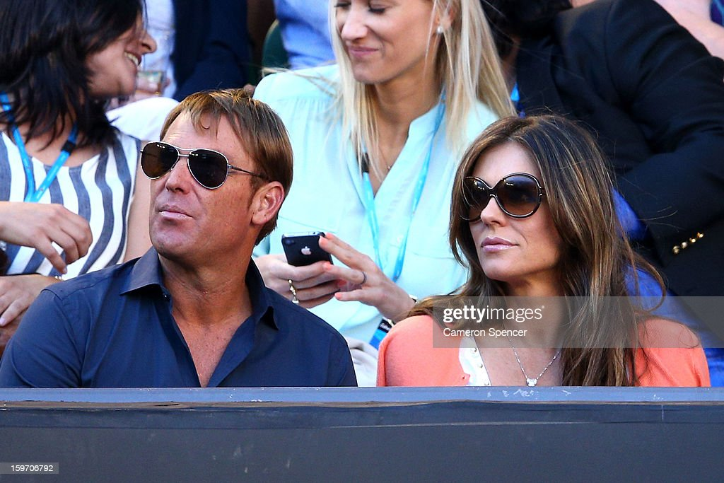 <a gi-track='captionPersonalityLinkClicked' href=/galleries/search?phrase=Shane+Warne&family=editorial&specificpeople=167242 ng-click='$event.stopPropagation()'>Shane Warne</a> and Liz Hurley watch the tennis during day six of the 2013 Australian Open at Melbourne Park on January 19, 2013 in Melbourne, Australia.