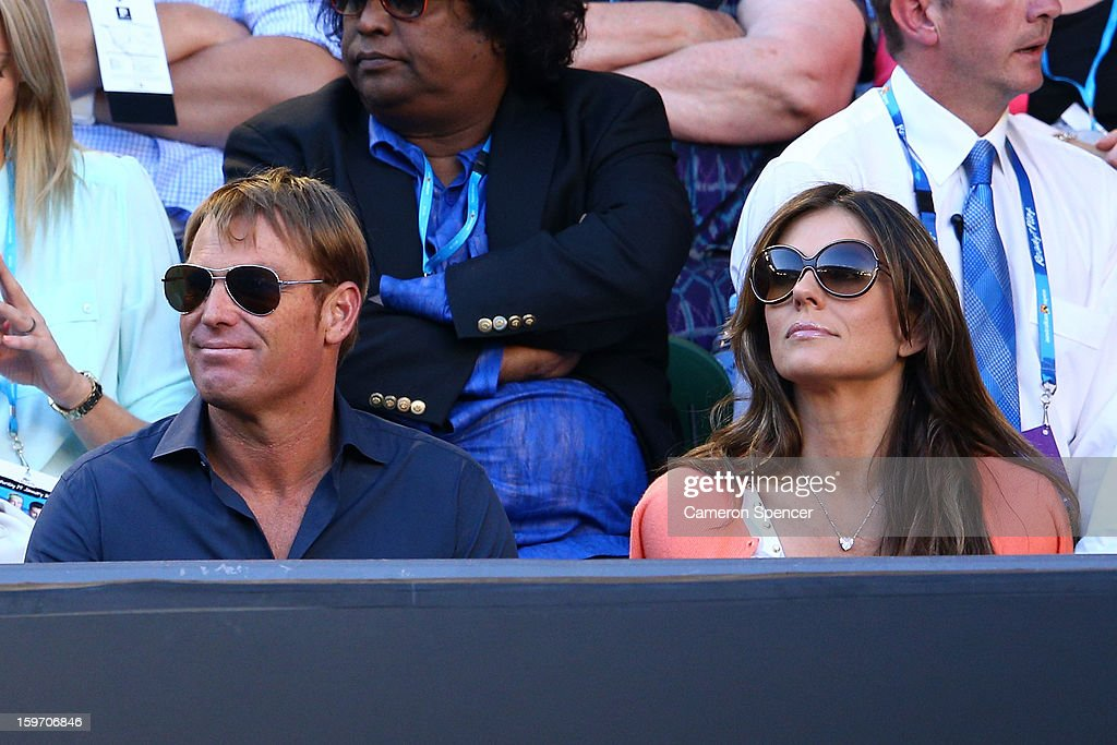 Shane Warne and Liz Hurley watch the tennis during day six of the 2013 Australian Open at Melbourne Park on January 19, 2013 in Melbourne, Australia.