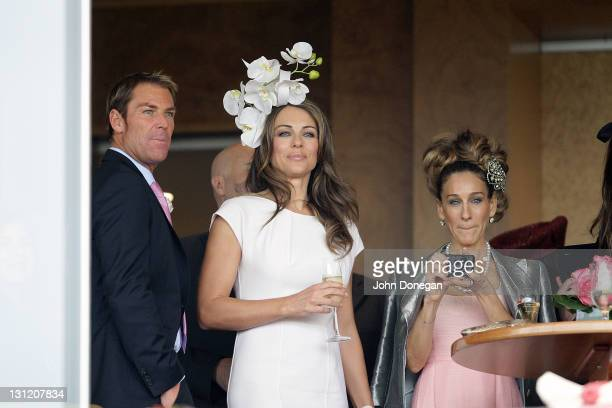 Shane Warne Elizabeth Hurley and Sarah Jessica Parker attend the Crown box during Crown Oaks Day at Flemington Racecourse on November 3 2011 in...