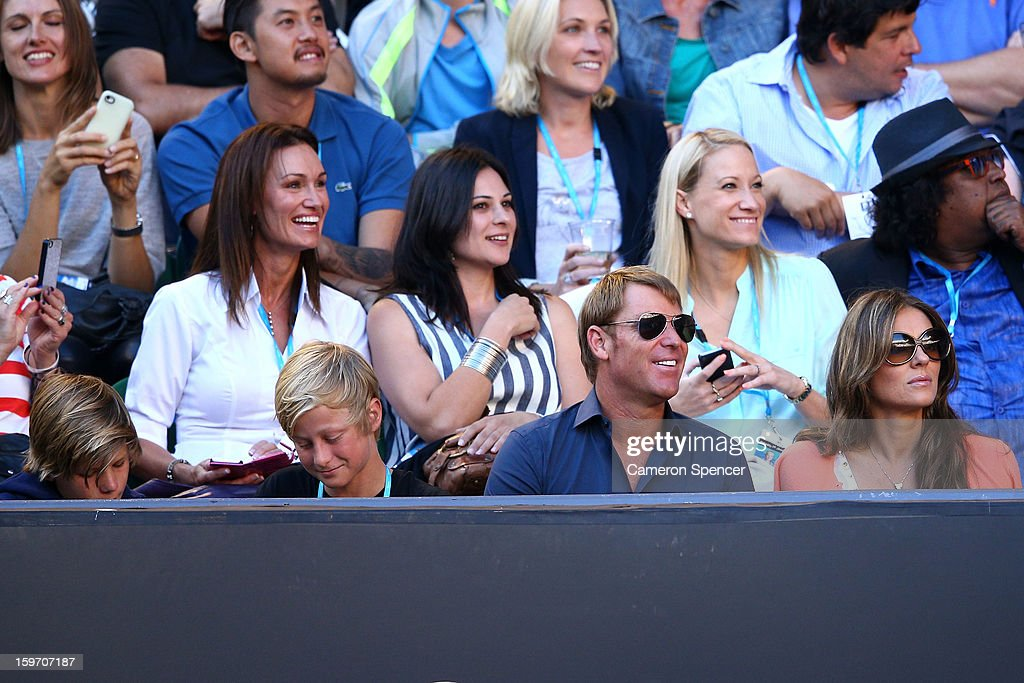 Shane Warne, Jackson Warne, Damien Hurley and Liz Hurley watch the tennis during day six of the 2013 Australian Open at Melbourne Park on January 19, 2013 in Melbourne, Australia.