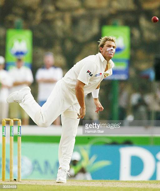 Shane Warne of Australia bowls his first over in Test Cricket since returning from suspension during day one of the First Test between Australia and...