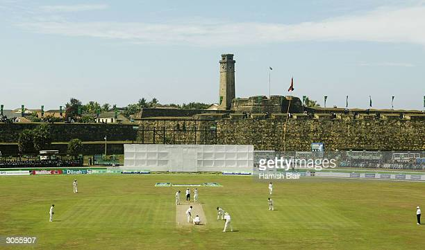 Shane Warne of Australia bowls under the Galle Fort during day two of the First Test between Australia and Sri Lanka played at the Galle...