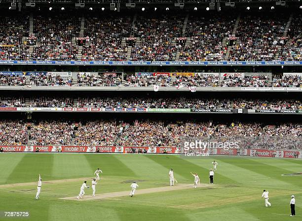 Shane Warne of Australia celebrates as he bowls out Andrew Strauss of England to claim his 700th test wicket during day one of the fourth Ashes Test...