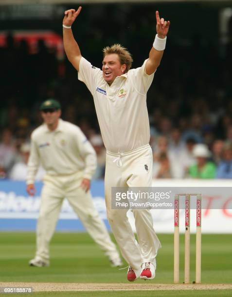 Shane Warne of Australia celebrates getting Marcus Trescothick of England caught by Matthew Hayden of Australia during the 1st Ashes Test match...