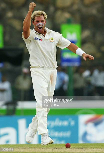 Shane Warne of Australia celebrates his first wicket in Test Cricket since returning from suspension after trapping Sanath Jayasuriya of Sri Lanka...
