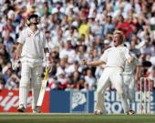 Shane Warne of Australia celebrates the wicket of Andrew Flintoff of England as Kevin Pietersen looks on during day five of the Fifth npower Ashes...