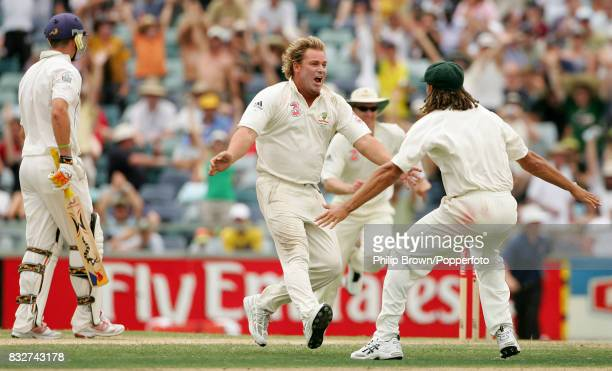 Shane Warne of Australia celebrates with Andrew Symonds after taking the final wicket of the match to win the 3rd Test between Australia and England...