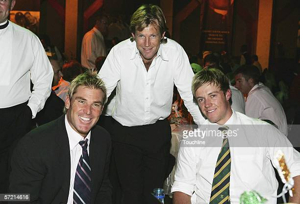 Shane Warne of Australia sits with Jonty Rhodes and AB de Villiers of South Africa during the Strength in Diversity Testimonial Dinner Tribute to...