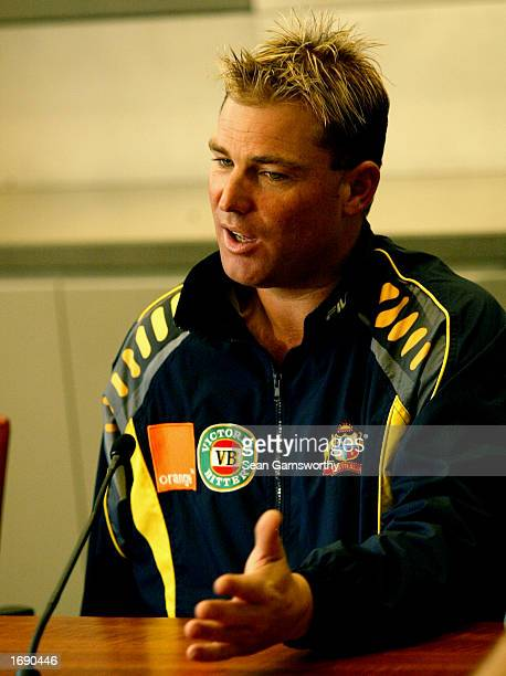 Shane Warne of Australia talks to the media regarding his shoulder injury at a press conference at the Australian Cricket Board headquarters in...